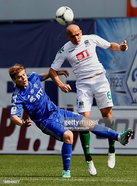 Aleksandr Kokorin of FC Dynamo Moscow is challenged by Ruslan Nakhushev of FC Krasnodar during the Russian Premier League match between FC Dynamo...