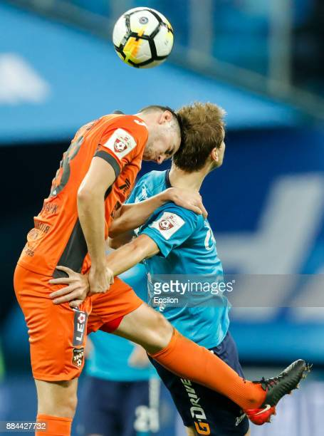 Aleksandr Kokorin of FC Zenit Saint Petersburg and Nikita Chernov of FC Ural Ekaterinburg vie for a header during the Russian Football League match...
