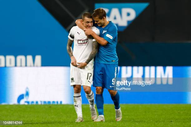 Aleksandr Kokorin of FC Zenit Saint Petersburg and Pavel Mamaev of FC Krasnodar talk after the Russian Premier League match between FC Zenit Saint...