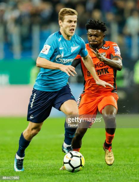 Aleksandr Kokorin of FC Zenit Saint Petersburg and Petrus Boumal of FC Ural Ekaterinburg vie for the ball during the Russian Football League match...