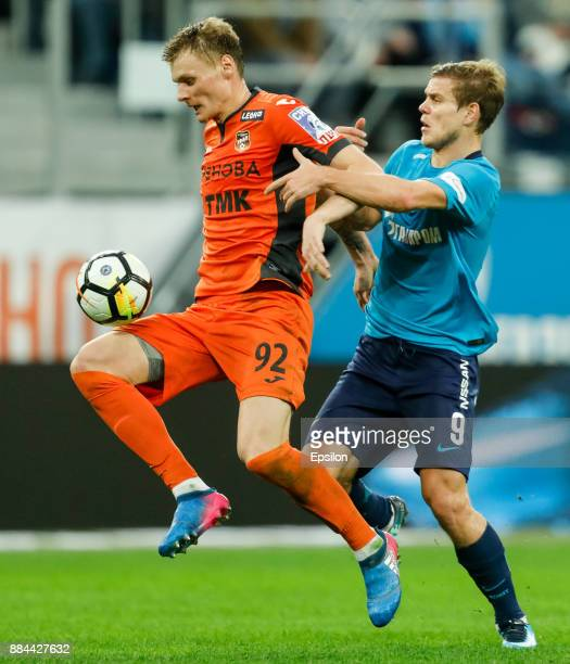 Aleksandr Kokorin of FC Zenit Saint Petersburg and Roman Yemelyanov of FC Ural Ekaterinburg vie for the ball during the Russian Football League match...