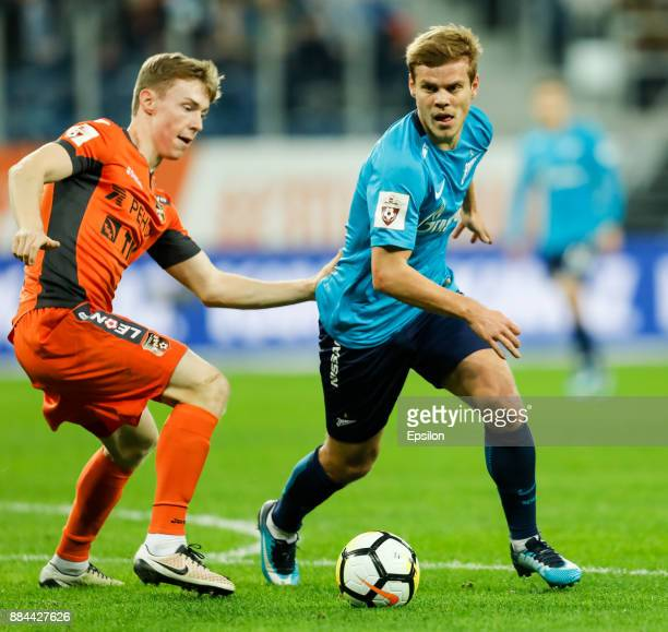 Aleksandr Kokorin of FC Zenit Saint Petersburg and Vladimir Ilyin of FC Ural Ekaterinburg vie for the ball during the Russian Football League match...