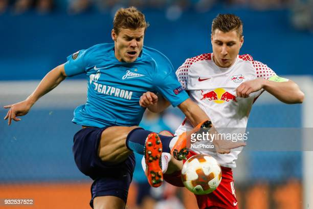 Aleksandr Kokorin of FC Zenit Saint Petersburg and Willi Orban of RB Leipzig vie for the ball during the UEFA Europa League Round of 16 second leg...