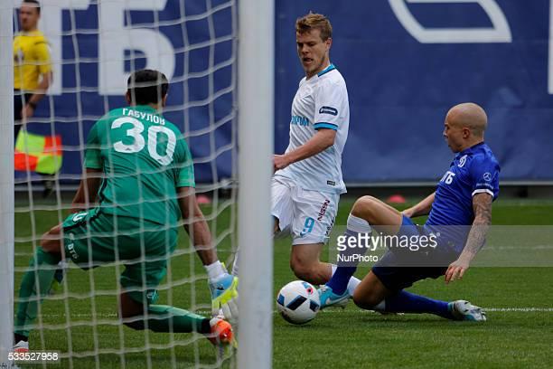 Aleksandr Kokorin of FC Zenit St Petersburg vies for the ball with Vladimir Gabulov of FC Dynamo Moscow and Sebastian Holmen of FC Dynamo Moscow...