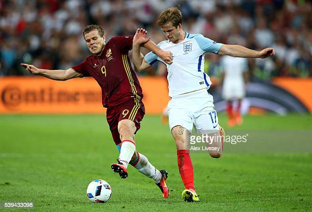 Aleksandr Kokorin of Russia and Eric Dier of England compete for the ball during the UEFA EURO 2016 Group B match between England and Russia at Stade...