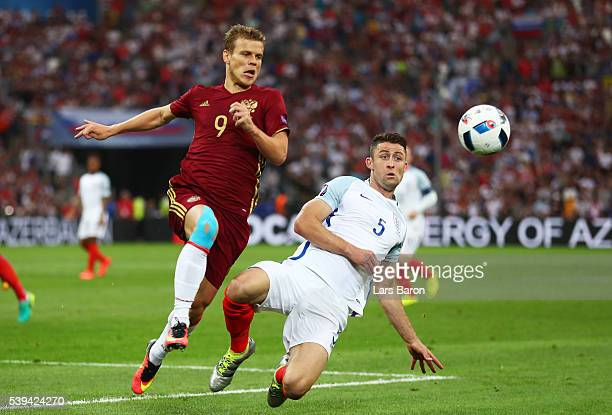 Aleksandr Kokorin of Russia and Gary Cahill of England compete for the ball during the UEFA EURO 2016 Group B match between England and Russia at...