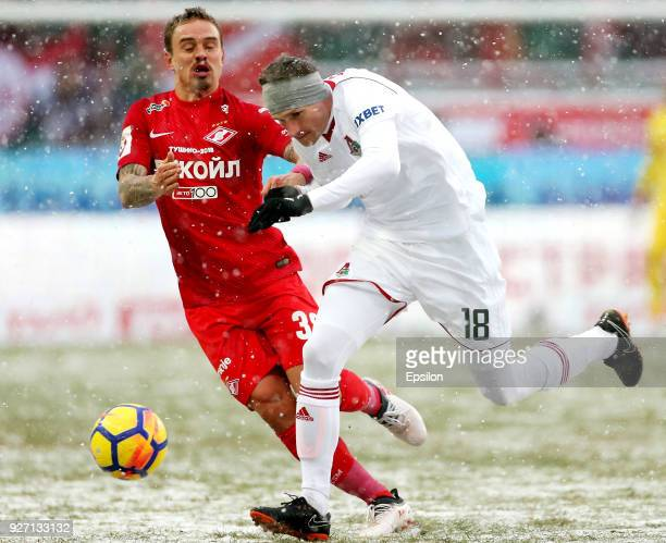 Aleksandr Kolomeytsev of FC Lokomotiv Moscow vies for the ball with Andrey Yeshchenko of FC Spartak Moscow during the Russian Premier League match...