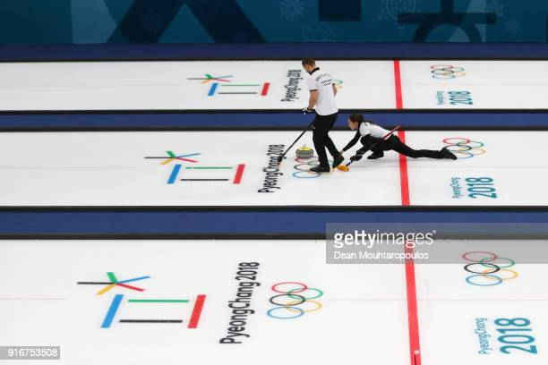 Aleksandr Krushelnitckii and Anastasia Bryzgalova of Olympic Athlete from Russia compete during the Curling Mixed Doubles on day two of the...