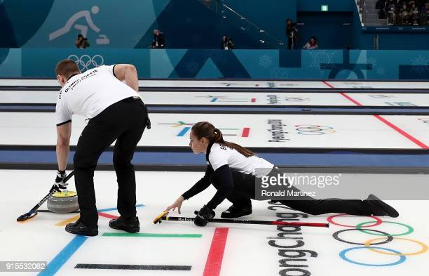 Aleksandr Krushelnitckii and Anastasia Bryzgalova of Olympic Athletes from Russia deliver a stone in the Curling Mixed Doubles Round Robin Session 1...