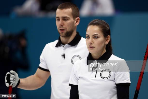 Aleksandr Krushelnitckii and Anastasia Bryzgalova of Olympic Athletes from Russia look on in the Curling Mixed Doubles Round Robin Session 1 during...