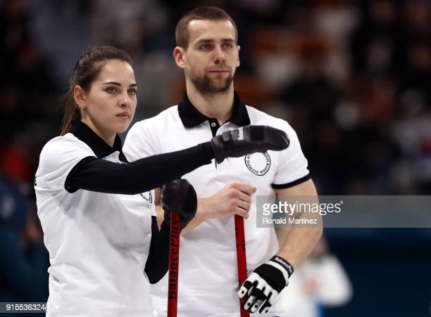 Aleksandr Krushelnitckii and Anastasia Bryzgalova of Olympic Athletes from Russia look on against United States in the Curling Mixed Doubles Round...
