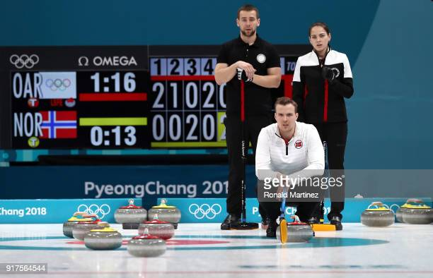 Aleksandr Krushelnitckii and Anastasia Bryzgalova of Olympic Athletes from Russia look on against Magnus Nedregotten of Norway during the Curling...