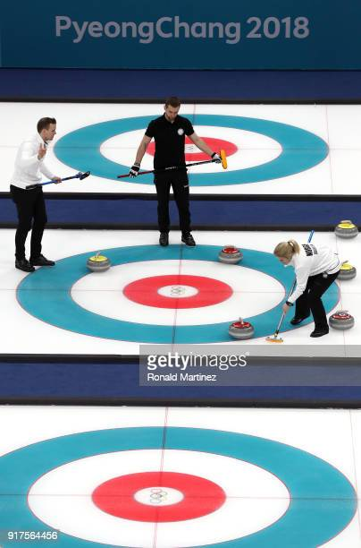 Aleksandr Krushelnitckii of Olympic Athletes from Russia competes against Magnus Nedregotten and Kristin Skaslien of Norway during the Curling Mixed...