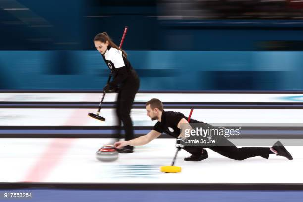 Aleksandr Krushelnitckii of Olympic Athletes from Russia delivers a stone against Norway during the Curling Mixed Doubles Bronze Medal Game on day...
