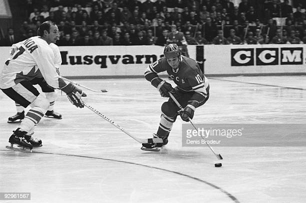 Aleksandr Maltsev of Team USSR plays against Bill White of Team Canada during the 1972 Summit Series September 1972 Luzhniki Ice Palace Moscow Soviet...