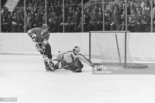 Aleksandr Maltsev of the Soviet Union shoots the puck past goalie Gerry Cheevers of team Canada during a Summit Series game September, 1974 in...