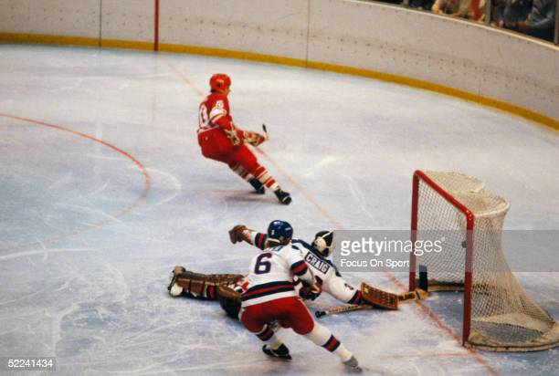 Aleksandr Maltsev of the USSR scores against Jim Craig and Bill Baker of Team USA during the XIII Olympic Winter Games on February 22 1980 in in Lake...