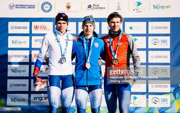 Aleksandr Podolskii of Russia Egor Shkolin of Russia and Vetle Stangeland of Norway celebrate in the NeoSenior Mens 3000m sprint race during the ISU...