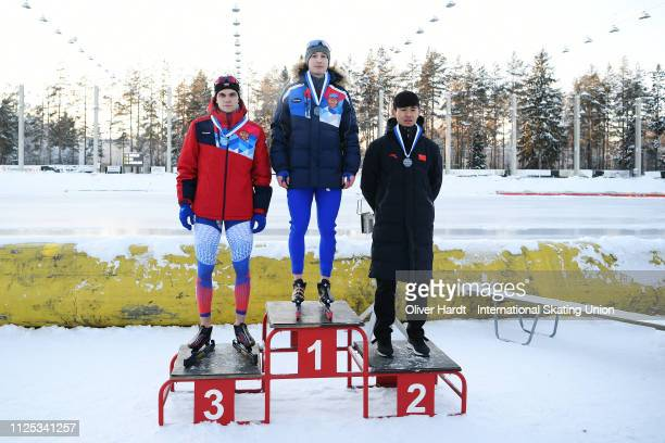 Aleksandr Podolskii of Russia with the bronze medal Egor Shkolin of Russia with the gold medal and Xinxuan Ma of China with the silver medal...