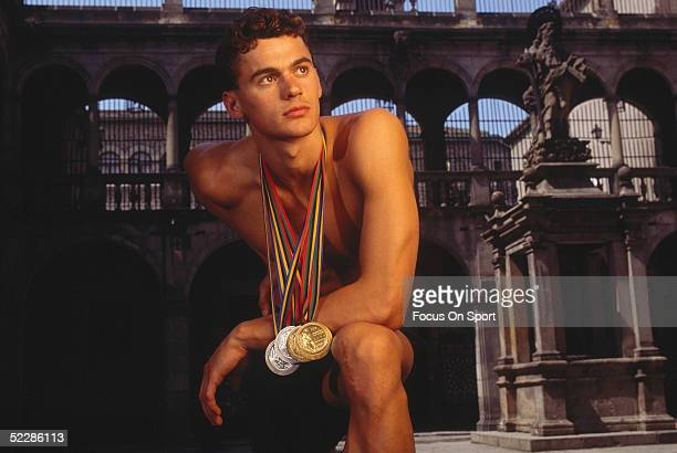 Aleksandr Popov poses for a portrait with his swimming medals from the 1992 Summer Olympics XXV in Barcelona Spain