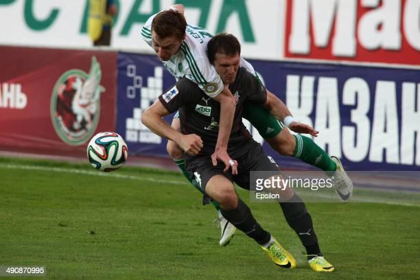 Aleksandr Prudnikov of FC Rubin Kazan is challenged by Andrei Semyonov of FC Terek Grozny during the Russian Football League Championship match...