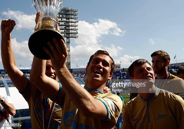 Aleksandr Ryazantsev Aleksandr Kerzhakov Andrey Arshavin and Nicolas Lombaerts of FC Zenit St Petersburg celebrate the Russian Championship title...
