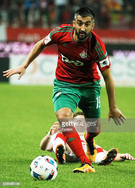 Aleksandr Samedov of FC Lokomotiv Moscow and Jano Ananidze of FC Spartak Moscow vie for the ball during the Russian Football League match between FC...