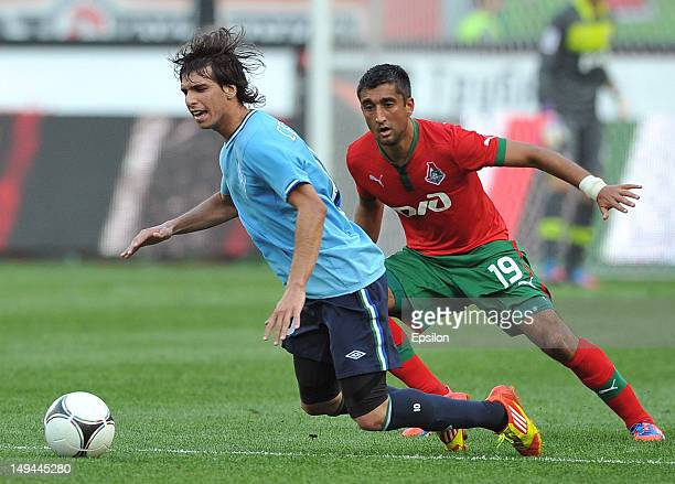 Aleksandr Samedov of FC Lokomotiv Moscow battles for the ball with Pablo Zeballos of FC Krylia Sovetov Samara during the Russian Premier League match...