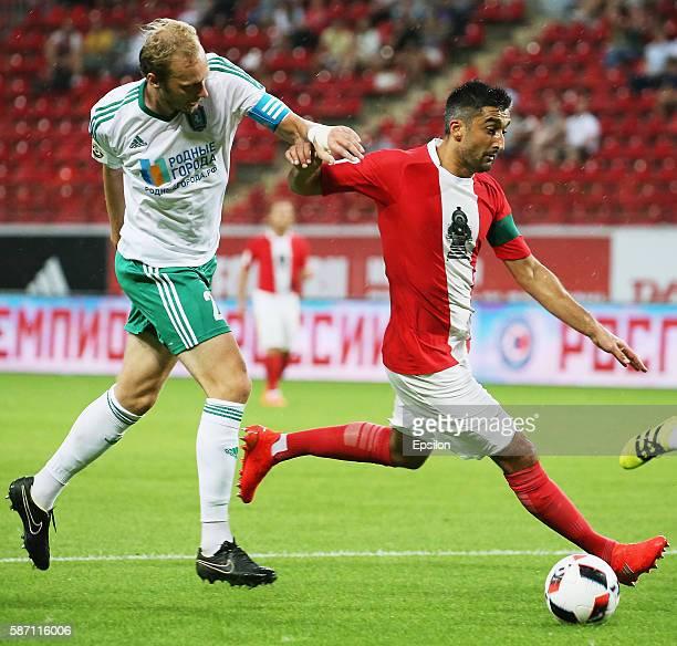 Aleksandr Samedov of FC Lokomotiv Moscow challenged by Maksim Bardachow of FC Tom Tomsk during the Russian Premier League match between FC Lokomotiv...