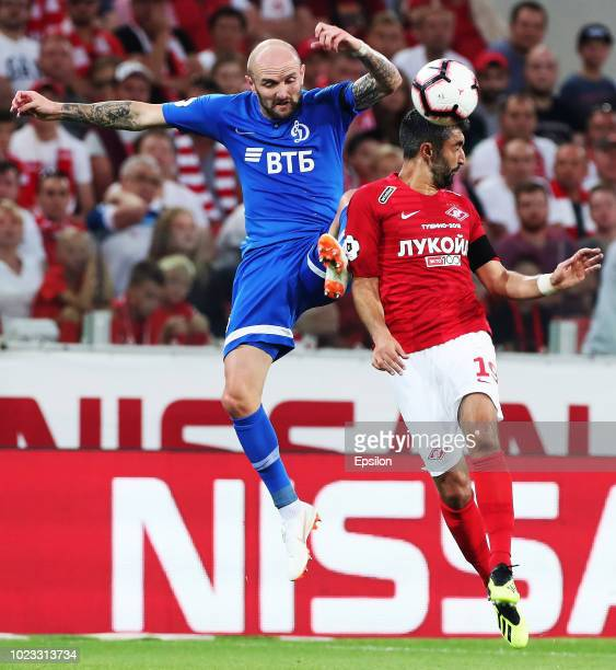 Aleksandr Samedov of FC Spartak Moscow and Konstantin Rausch of FC Dinamo Moscow vie for the ball during the Russian Football League match between FC...