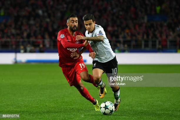 Aleksandr Samedov of Spartak Moskva and Philippe Coutinho of Liverpool battle for possession during the UEFA Champions League group E match between...