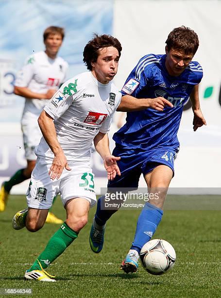 Aleksandr Sapeta of FC Dynamo Moscow is challenged by Mauricio Pereyra of FC Krasnodar during the Russian Premier League match between FC Dynamo...