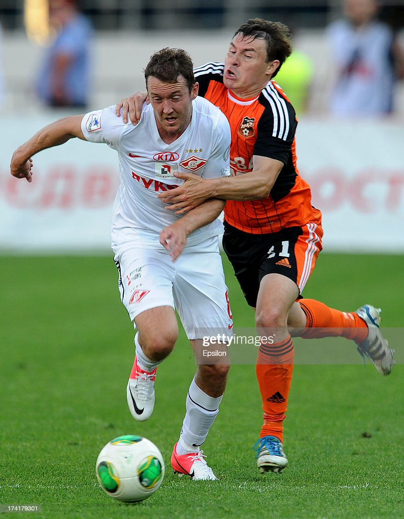 Aleksandr Shchanitsyn (R) of FC Ural Sverdlovsk Oblast challenges Aiden McGeady of FC Spartak Moscow during the Russian Premier League match betweenn FC Ural Sverdlovsk Oblast and FC Spartak Moscow at the Tcentralny Stadium on July 21, 2013 in Ekaterinburg, Russia.
