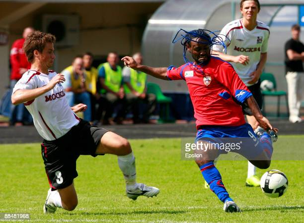 Aleksandr Sheshukov of FC Moscow battles for the ball with Vagner Love of PFC CSKA Moscow during the Russian Football League Championship match...