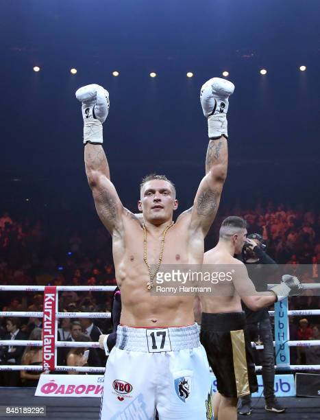 Aleksandr Usyk of Ukraine celebrates after winning the WBO Cruiserweight World Boxing Super Series fight against Marco Huck of Germany at Max...