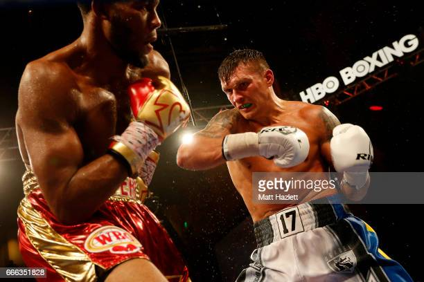 Aleksandr Usyk of Ukraine exchanges punches with Mike Hunter during their WBO Cruiserweight World Championship bout at The Theater at MGM National...