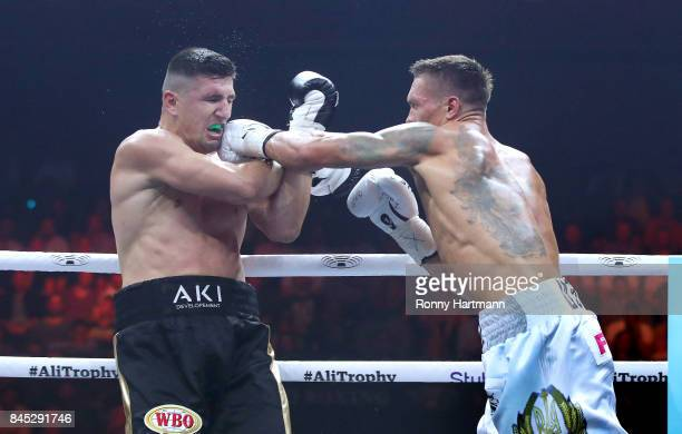 Aleksandr Usyk of Ukraine punches Marco Huck of Germany during the WBO Cruiserweight World Boxing Super Series fight at Max Schmeling Halle on...