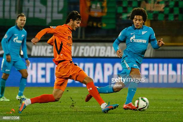 Aleksandr Yerokhin of FC Ural Sverdlovsk Oblast and Axel Witsel of FC Zenit St Petersburg vie for the ball during the Russian Football League match...