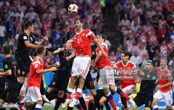 Aleksandr Yerokhin of Russia jumps up th head the ball during the 2018 FIFA World Cup Russia Quarter Final match between Russia and Croatia at Fisht...