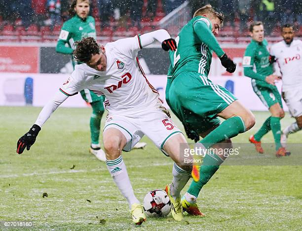 Aleksandr Zhirov of FC Tom Tomsk and Aleksei Miranchuk of FC Lokomotiv Moscow vie for the ball during the Russian Football League match between FC...