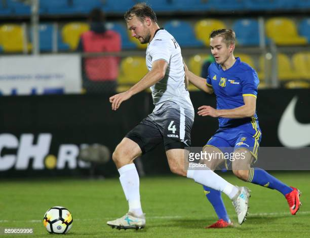 Aleksandr Zuyev of FC Rostov RostovonDon vies for the ball with Aleksei Nikitin of FC Ufa during the Russian Premier League match between FC Rostov...