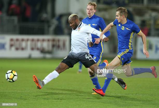 Aleksandr Zuyev of FC Rostov RostovonDon vies for the ball with Sly of FC Ufa during the Russian Premier League match between FC Rostov RostovonDon v...