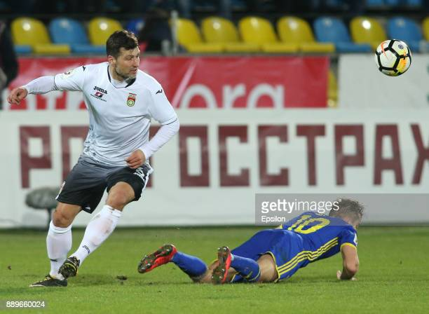 Aleksandr Zuyev of FC Rostov RostovonDon vies for the ball with Vero Salatic of FC Ufa during the Russian Premier League match between FC Rostov...