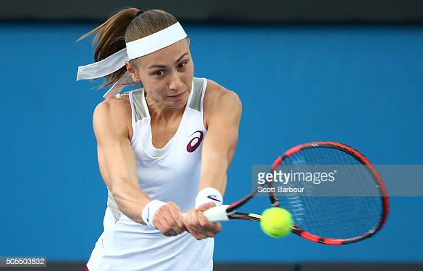 Aleksandra Krunic of of Serbia plays a backhand in her first round match against Eugenie Bouchard of Canada during day one of the 2016 Australian...