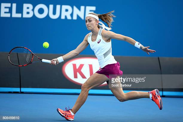 Aleksandra Krunic of of Serbia plays a forehand in her first round match against Eugenie Bouchard of Canada during day one of the 2016 Australian...