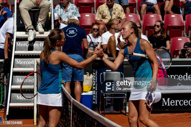 Aleksandra Krunic of Serbia and Johanna Larsson of Sweden thank each other for the match during day four of the 2019 Swedish Open WTA on July 11 2019...