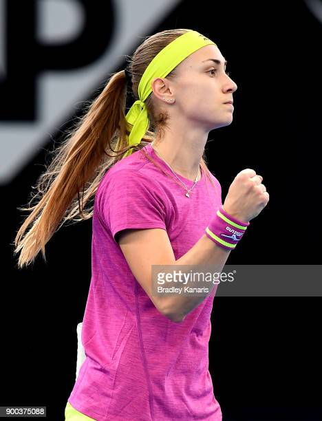 Aleksandra Krunic of Serbia celebrates winning a point in her match against Garbine Muguruza of Spain during day three of the 2018 Brisbane...