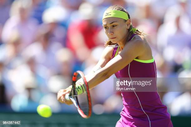 Aleksandra Krunic of Serbia in action against Johanna Konta of Great Britain during day five of the Nature Valley International at Devonshire Park on...