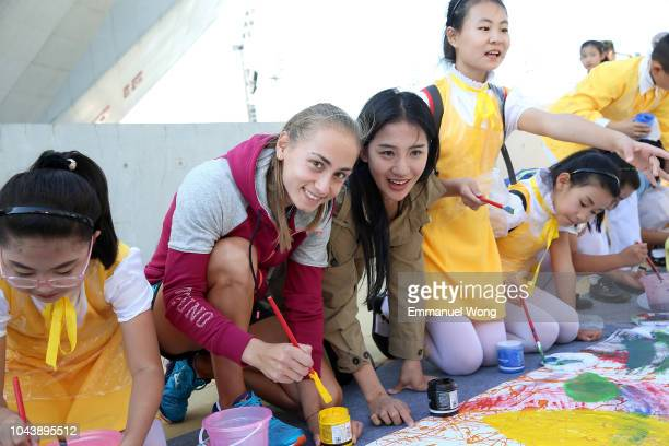 Aleksandra Krunic of Serbia paints during the Little Painter event on day three of 2018 China Open at the China National Tennis Centre on October...