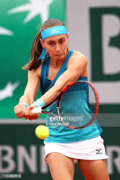 Aleksandra Krunic of Serbia plays a backhand during her ladies singles second round match against Lesia Tsurenko of Ukraine during Day five of the...